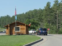 Custer State Park entrance, South Dakota. Custer County, South Dakota--July 2018: A vehicle stops to pay the admission fee at Custer State Park in South Dakota stock photo