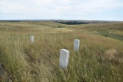 Custers last stand field markers at edge of main battlefiels site. Field markers where George Custer`s men fell after being killed by Indians at battle of stock photos