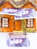 Custo elevado de comprar a propriedade: hipotecas. Fotos de Stock