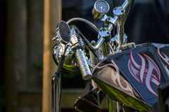 Custom Bike. Cool custom chopper motorcycle. Chrome handlebars, black design tank Stock Images
