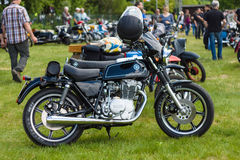 Custom bike based on the Yamaha XS250. PAAREN IM GLIEN, GERMANY - MAY 23, 2015: Custom bike based on the Yamaha XS250. The oldtimer show in MAFZ stock images