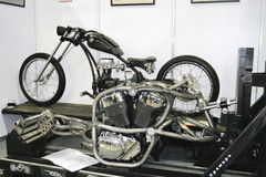 Custom bike chopper in the course of gathering. MOSCOW - APRIL 1: Custom motorcycle bike chopper in the course of gathering at the Moscow specialized Exhibition royalty free stock photography