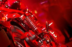 Custom Bikes 3. An abstract of a custom built motorcycle at an afterparty in a nightclub. Strong red color cast Stock Image