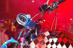 Custom Bikes 4. An abstract of a custom built motorcycle at an afterparty in a nightclub. Strong red color cast Stock Photos