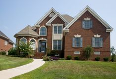 Custom brick home. Custom build, large, upscale brick home Royalty Free Stock Photography