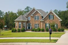 Custom brick home. Custom, large upscale brick home Royalty Free Stock Images