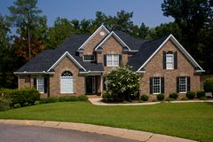 Custom brick home. Custom, upscale brick home on sloped lot Royalty Free Stock Images