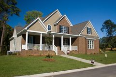 Custom brick home 7. Custom, upscale brick home with  shake siding Stock Image