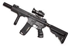 Custom build compact size M4A1 assault carbine. With RIS/RAS, tactical handguard, crane stock and red-dot sight. Isolated on a white background. Weapon series Royalty Free Stock Image