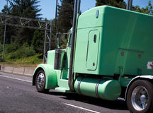 Custom build individual green original big rig semi truck with c Stock Photography