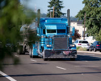 Custom build monster blue big rig semi truck with stainless stee. The custom-built exclusive big rig blue semi truck in classic trucking style with chrome parts Stock Image