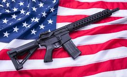 Custom built AR-15 carbine on American flag surface, background. Studio shot. stock images