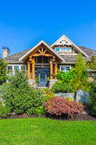 Custom built house. Custom built luxury house with nicely trimmed and designed front yard, lawn in a residential neighborhood, Canada Royalty Free Stock Image