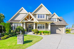 Custom built house. Custom built luxury house with nicely trimmed and designed front yard, lawn in a residential neighborhood, Canada Stock Photos