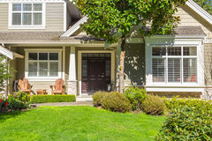 Custom built house. Custom built luxury house with nicely trimmed and designed front yard, lawn in a residential neighborhood, Canada Royalty Free Stock Photography