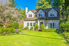 Custom built house. Custom built luxury house with nicely trimmed and designed front yard, lawn in a residential neighborhood, Canada stock photo