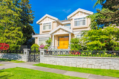 Custom built house. Custom built luxury house with nicely trimmed and designed front yard, lawn in a residential neighborhood, Canada stock image