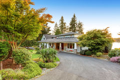 Custom built luxury house with long concrete driveway. Stock Photo