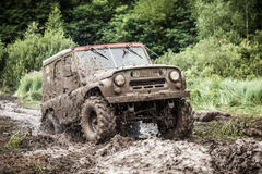 Custom built Off-road Trophy UAZ 469 passing mud pit. royalty free stock image