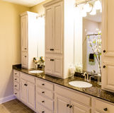 Custom Cabinets in New Bathroom Stock Image