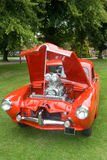 Custom car. Red car with bonnet open showing engine Royalty Free Stock Photos