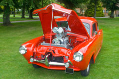 Custom car. Red car with bonnet open showing engine Royalty Free Stock Images