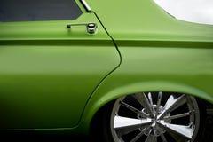 Custom car detail. Green custom car bodywork detail Stock Images