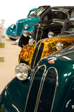 Custom cars. Row of four customized retro cars at a show stock photography