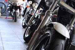 Custom chopper motorcycles in showroom of motorbike dealership store Stock Photo