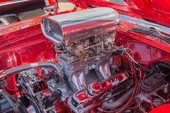 Custom Chromed Hot Rod Motor. A customized, chromed hot rod motor with two four barrel carburetors Royalty Free Stock Photos