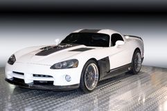 Custom Dodge Viper, 3/4 View. A custom Dodge Viper isolated on a gradient black and white background. Clipping path of background included. Many more car photos Royalty Free Stock Photo