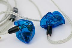 Custom In Ear Monitors. Blue custom In Ear Monitors with Dolphin cables Royalty Free Stock Image