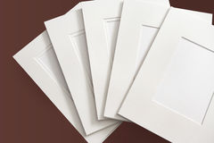 Custom Framing. A selection of soft white matboard blanks Stock Photo