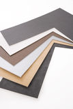 Custom Framing. A selection of matboard corner samples on a white background Stock Image