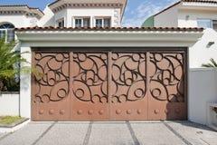 Custom Garage Door. On a Spanish inspired home Royalty Free Stock Photo