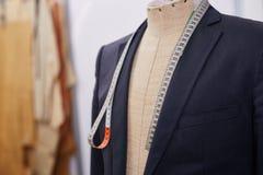 Custom Garments in Atelier Studio. Custom made tailored suit on mannequin in atelier studio Stock Photography
