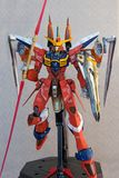 Custom hand painted attack full pose Freedom Gundam. Jumping and attacking pose of my custom hand painted Freedom Gundam action figure front shot,  makes a nice royalty free stock photography