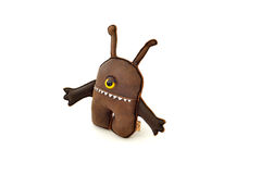 Custom handcrafted stuffed leather toy alien - right Stock Image