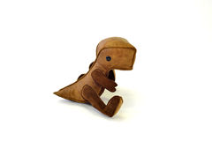custom handcrafted stuffed leather toy baby dinosaur - sitting Stock Photography