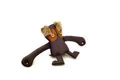 Custom handcrafted stuffed leather toy long armed freak - left Royalty Free Stock Photos