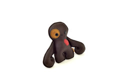 Custom handcrafted stuffed leather toy octopus - left Stock Image