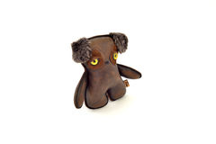 Custom handcrafted stuffed leather toy puppy - left Stock Image