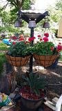 Custom hanging basket stand. Sturdy and durable for hanging baskets Stock Image