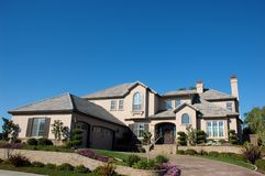 Custom Home. Grand custom home in an exclusive residential neighborhood Royalty Free Stock Photos