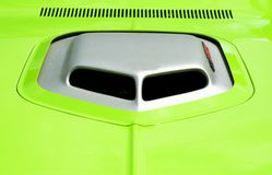 Custom hood scoop on neon green car Stock Photos