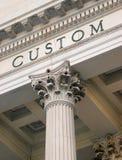 Custom house. Closeup of a custom house with corinthian pillers Stock Photo