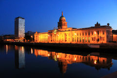 Custom House Reflections At Night, Dublin. The Custom House and Liberty Hall at night reflected in the river Liffey Royalty Free Stock Photos