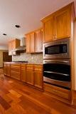 Custom kitchen. Renovated designer kitchen in a regular suburban house Stock Photos