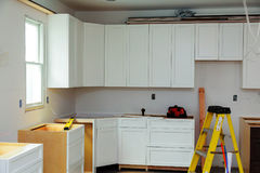 Custom kitchen cabinets in various stages of installation Stock Photos
