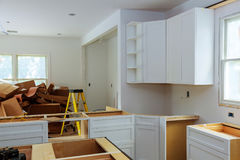 Custom kitchen cabinets in various stages of installation Royalty Free Stock Photo